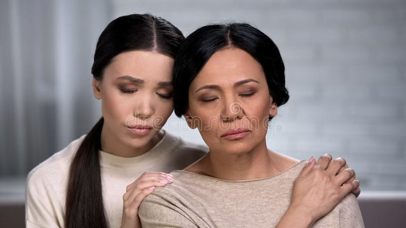 Adult woman feeling loneliness, daughter supporting mother, help of close friend stock images