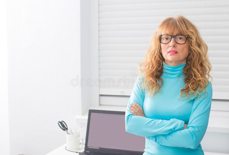 Adult woman with glasses and computer stock photo