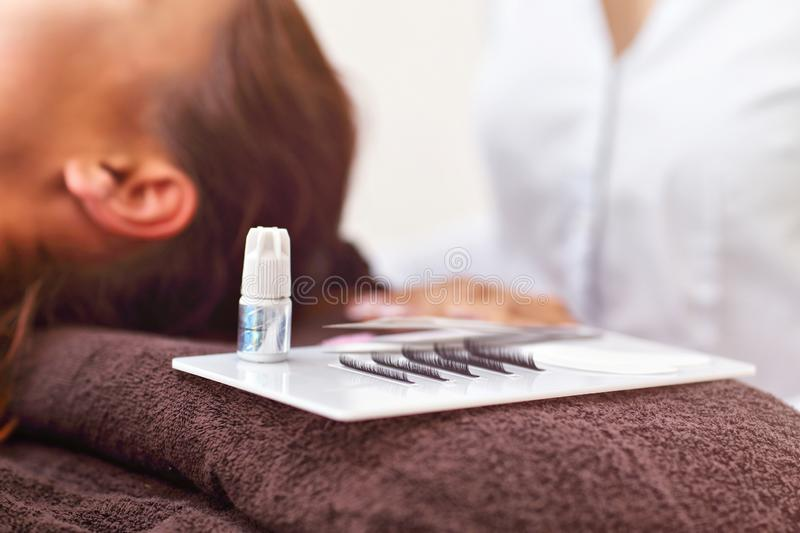 Adult woman having eyelash extension in professional beauty salon. Picture of adult women having eyelash extension in professional beauty salon royalty free stock images