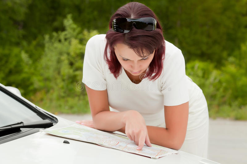 Adult woman looks at a map