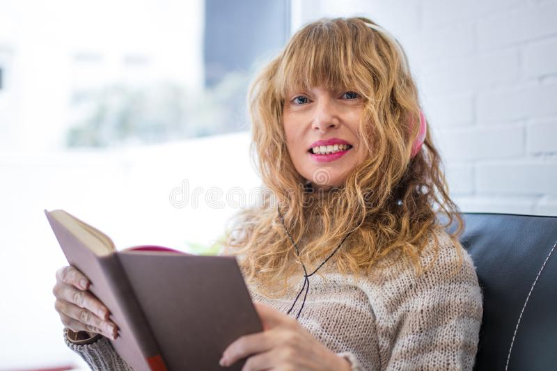 Adult woman reading the book stock photos