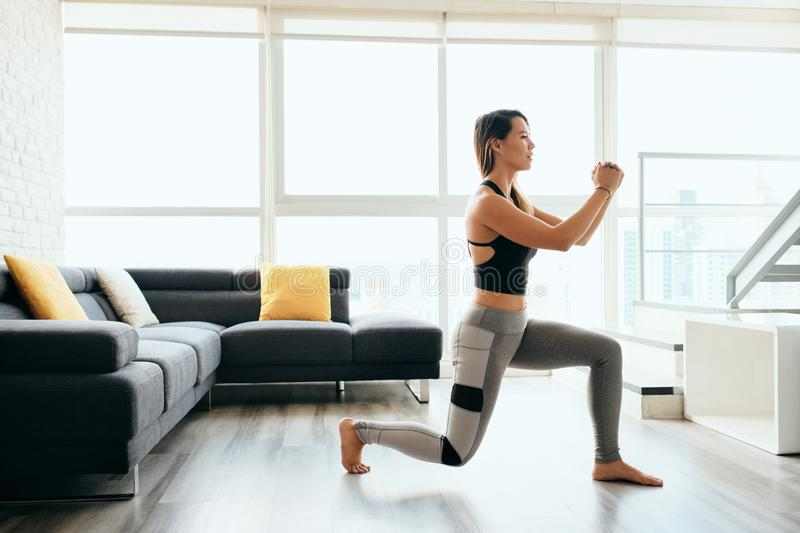 Adult Woman Training Legs Doing Inverted Lunges Exercise. Fit young Pacific Islander woman training at home. Beautiful female athlete working out for wellbeing royalty free stock photos