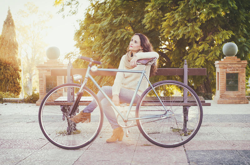Adult woman with vintage bike stock photo