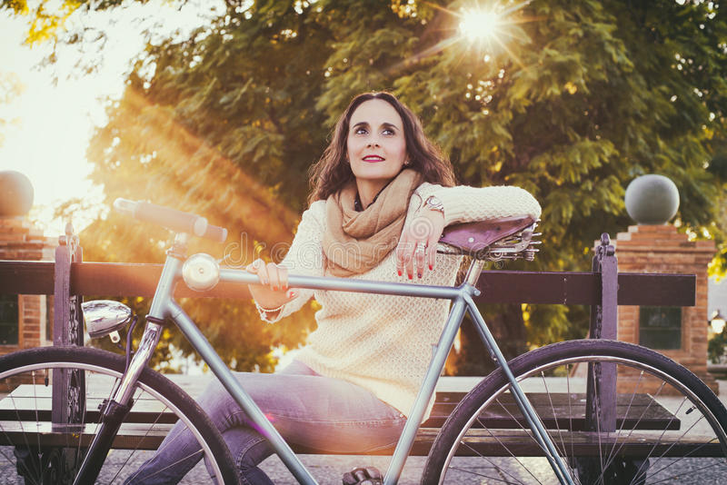Adult woman with vintage bike stock image