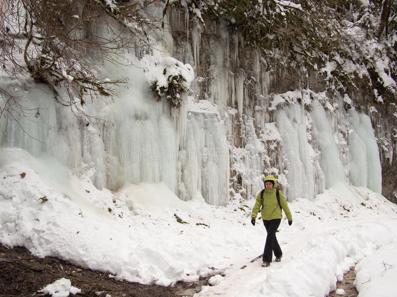 Adult woman walking along a mountain path stock image