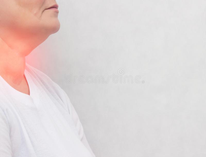 Adult woman who has problems with the thyroid gland, pain, nodes in the thyroid gland white background copy space endocrine system stock image