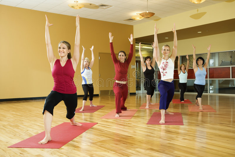 Adult woman in yoga class. stock photo