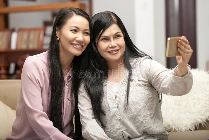 Adult women taking selfie with phone royalty free stock photos
