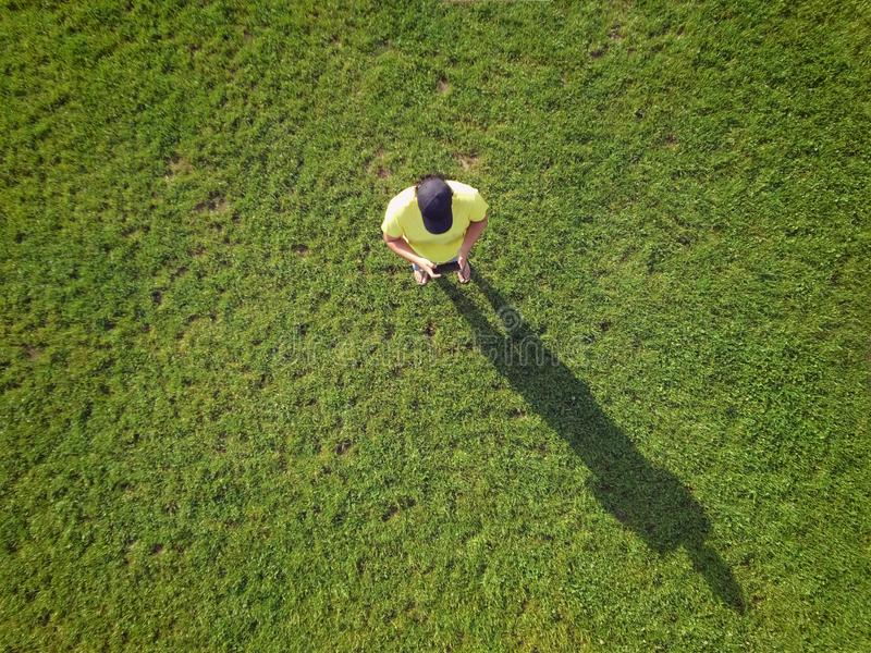 Adult young man is controlling his drone and taking some photos and videos. Aerial top view, technology and carefree lifestyle stock photos
