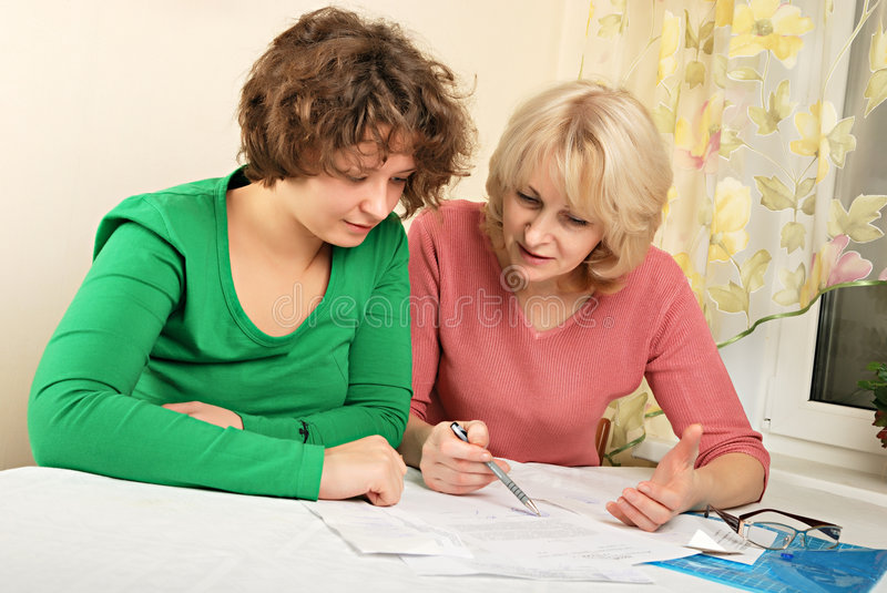 Adult and young women with documents stock photo