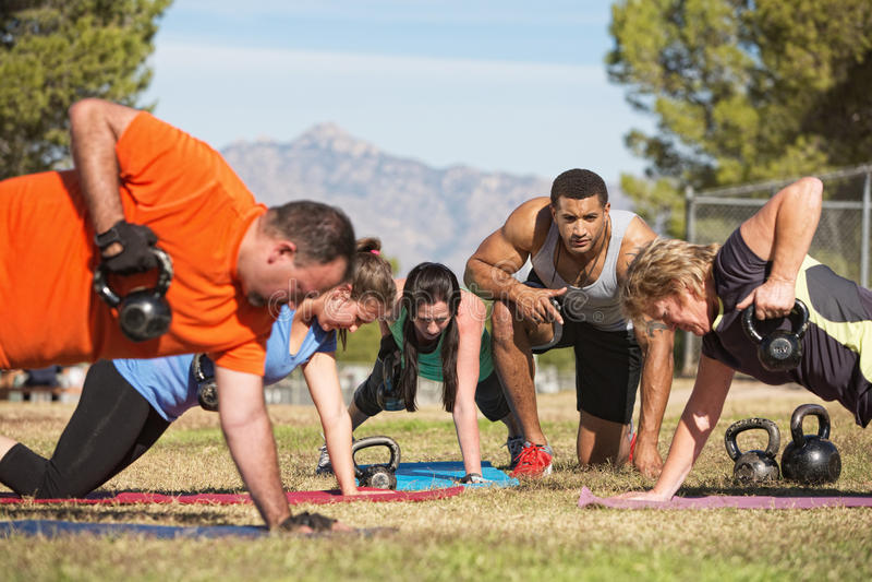 Adults Exercising Outdoors stock photos