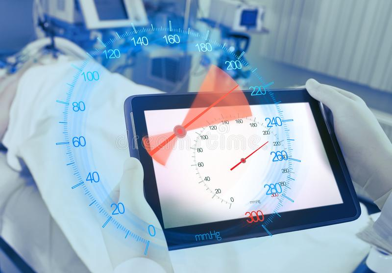 Advanced device for patient blood ressure monitoring in the doctors hand.  stock image