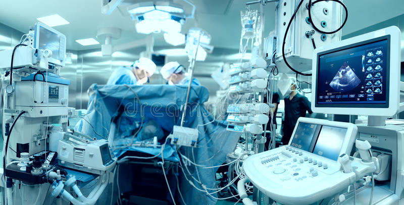 In advanced operating room. With lots of equipment, patient and working surgical specialists royalty free stock photo