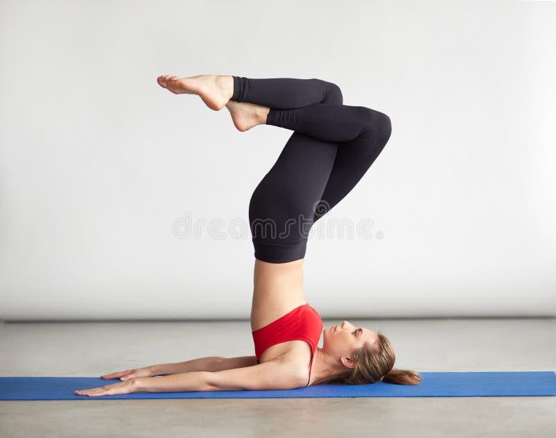 Download Advanced Yoga Halasana Pose With Twisted Legs Stock Photo
