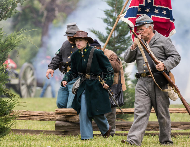 Advancing to the Fight. Civil War era soldiers in battle at the Dog Island reenactment in Red Bluff, California royalty free stock image