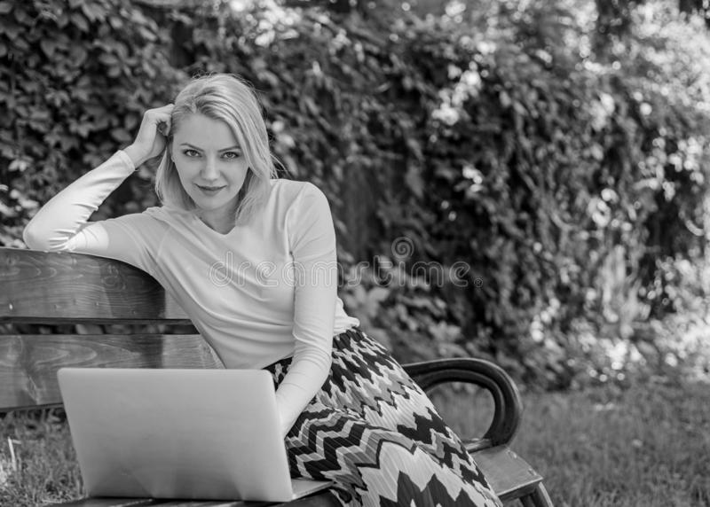 Advantages and disadvantages of becoming freelancer. Lady freelancer working in park. Freelance benefits. Woman with stock photo