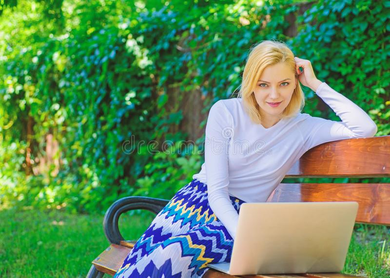 Advantages and disadvantages of becoming freelancer. Lady freelancer working in park. Freelance benefits. Woman with stock image
