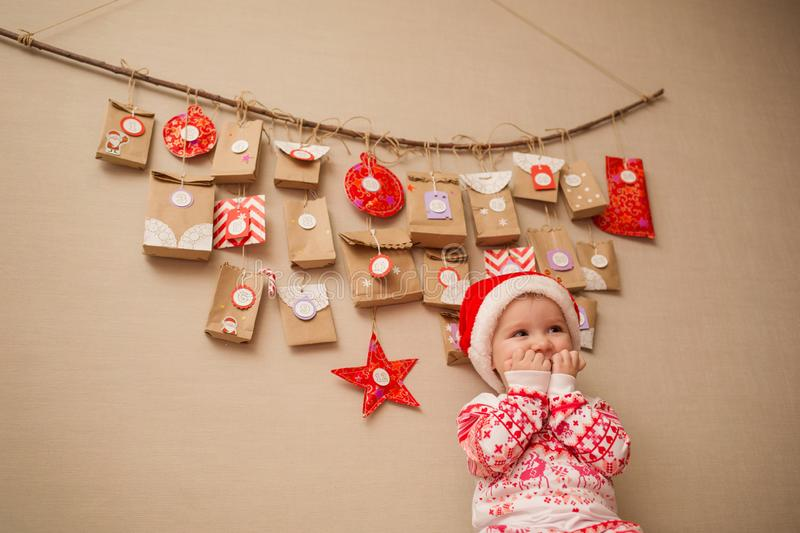 Advent calendar for kids. child in anticipation of the holiday.  stock image