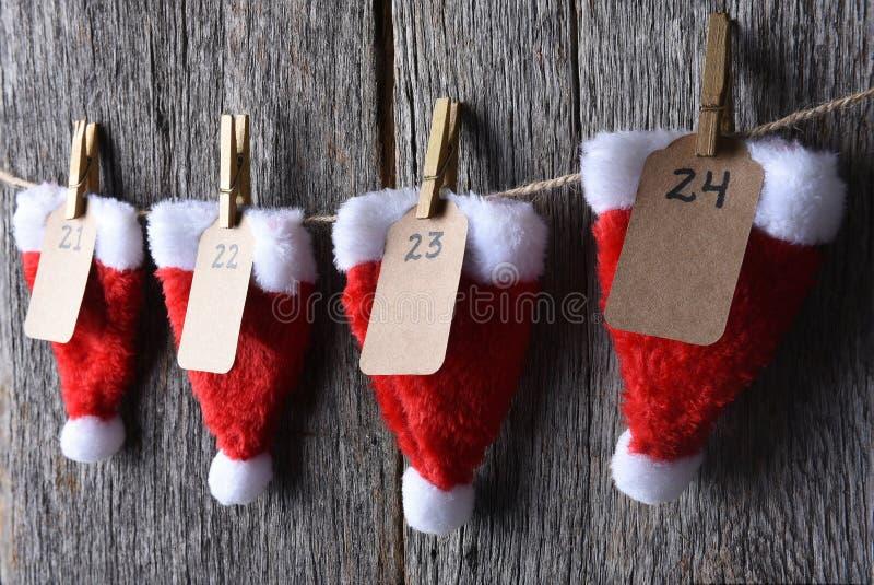 Advent Calendar Closeup. Advent Calendar made of Santa hats clothes pins and string stock photo