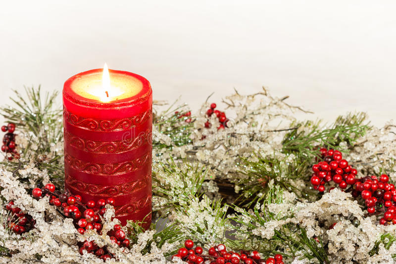 Advent Candle of Christmas Season. A rugged advent candle is decorated in the Christmas theme. Can be used as a background or in Christmas cards royalty free stock photography