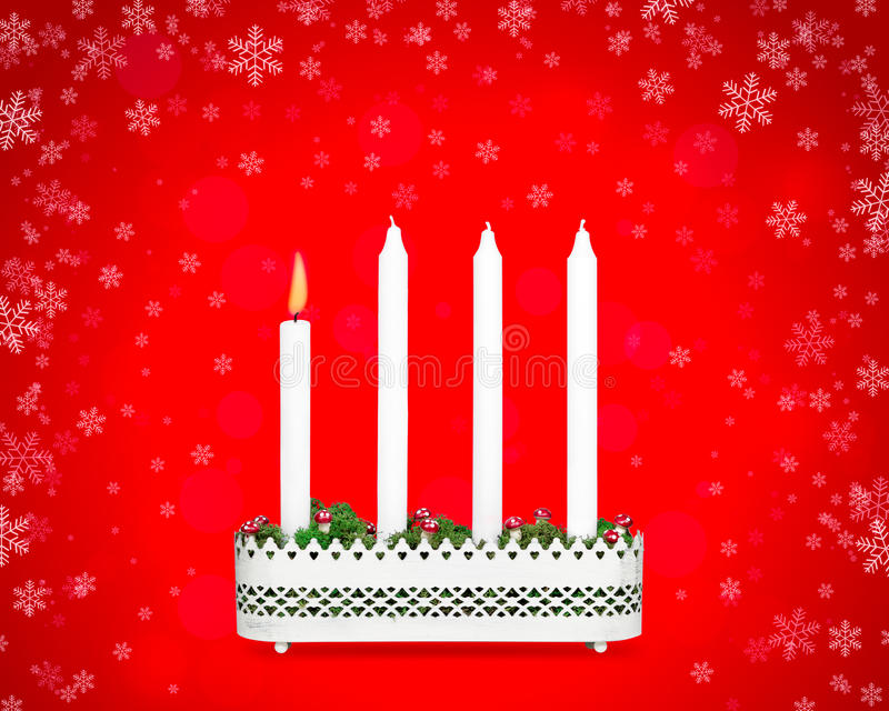 Advent candlestick with one burning candle. royalty free stock image