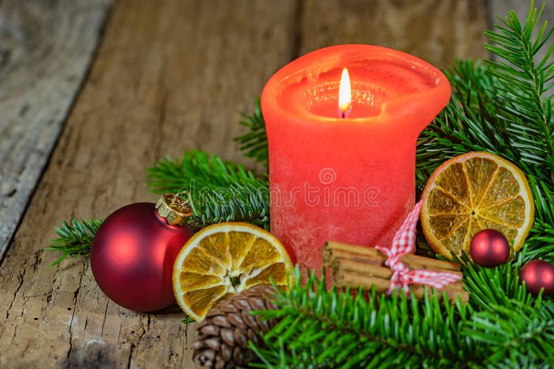 Advent and Christmas candle with green traditional decoration royalty free stock images