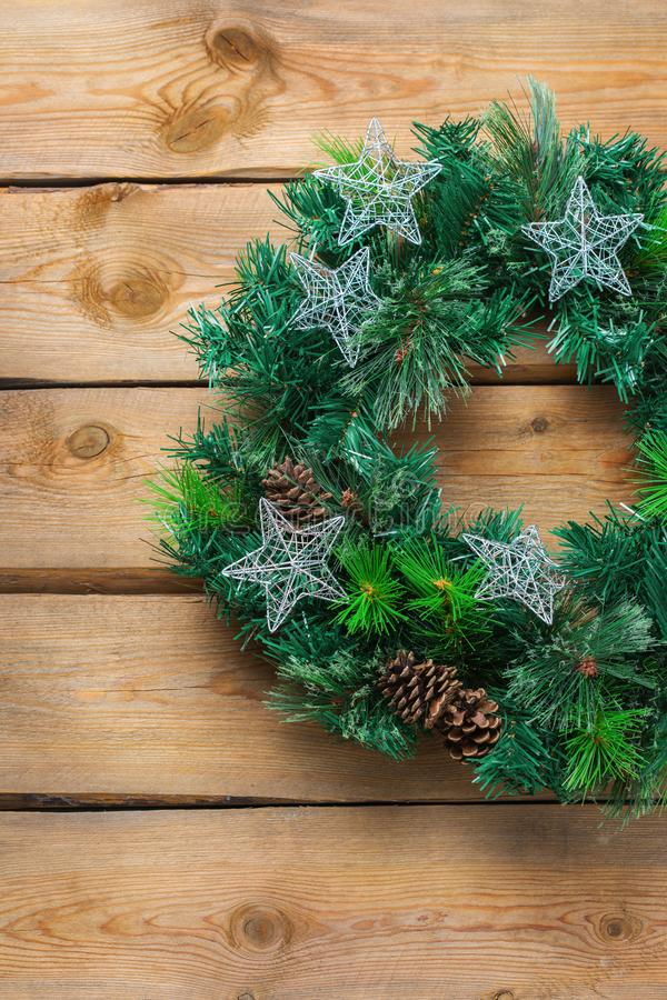 Advent christmas wooden door wreath with festive decoration royalty free stock photos