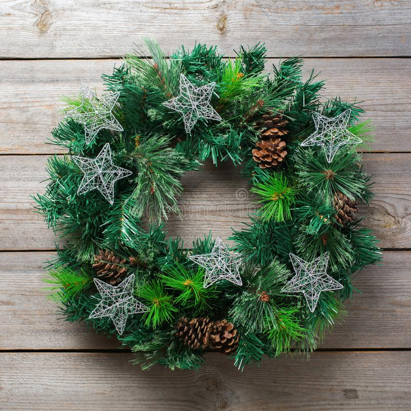 Advent christmas wooden door wreath with festive decoration stock photo