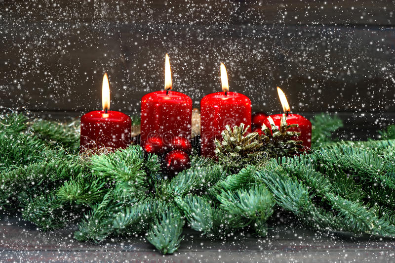 Advent decoration. Four red burning candles. Holidays background royalty free stock photos