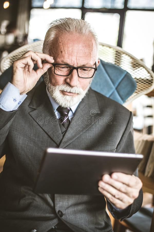 The advent of electrical documentation is now easier. Business man using digital tablet. Close up stock image