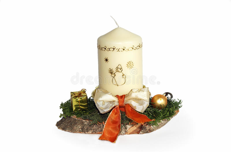 Advent spray with white candle. Advent spray with decorated white candle and beautiful ribbon, fresh green twigs on a timber slice, handicraft work selfmade stock photos