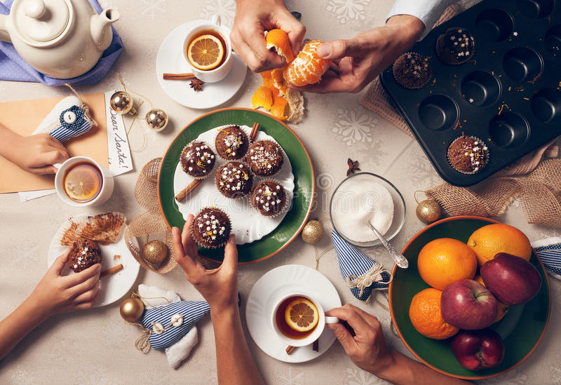 Advent time. Family tea party with homemade muffins stock image