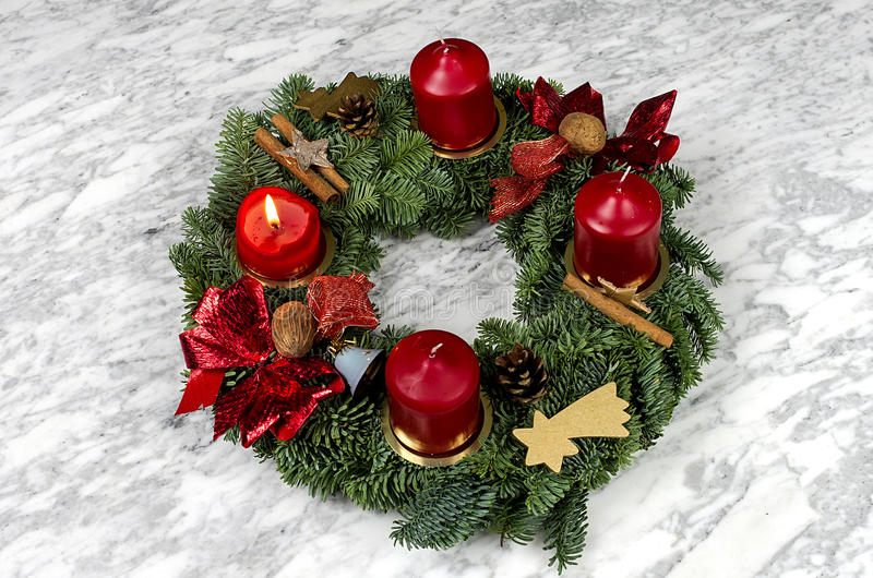 Advent wreath with burning candle. On a marble table stock photography