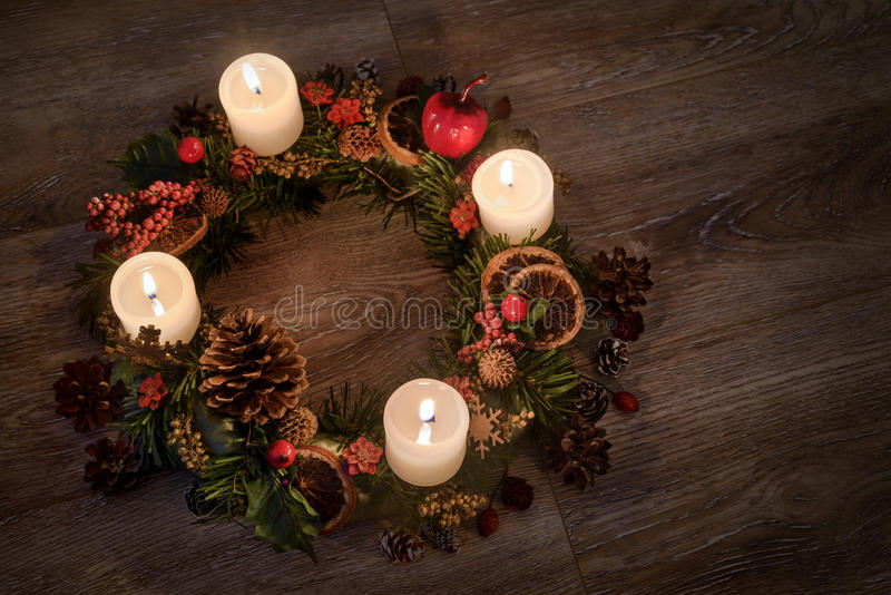 Advent wreath with burning candles for the Christmas time stock photography