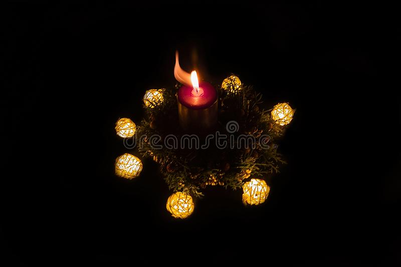 The Advent wreath with candles. The Advent wreath with lights and a candle royalty free stock photo