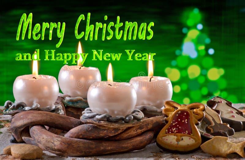Advent Wreath con Feliz Navidad del texto imágenes de archivo libres de regalías
