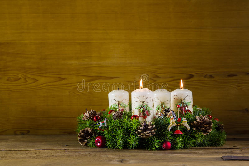 Advent wreath or crown with two burning white candles. royalty free stock image