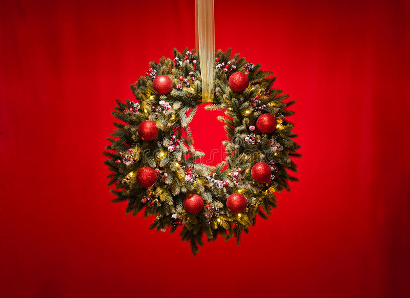 Advent wreath over red background. With gold ribbon royalty free stock images
