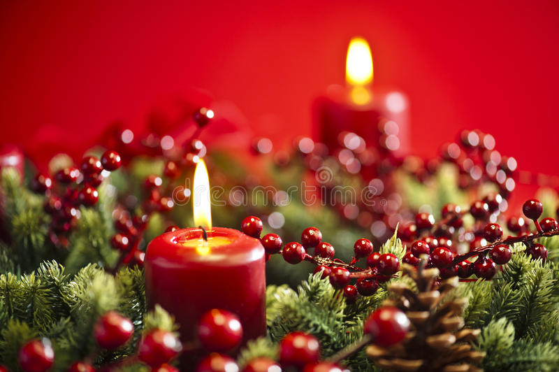 Advent wreath over red background. With winter rose and berries stock image