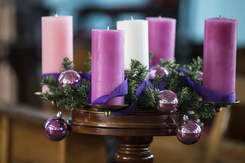 Advent wreath with pink candles. Advent wreath with rose, white and pink candles and pink balls royalty free stock images
