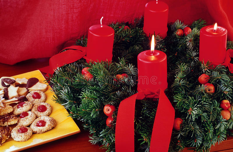 Advent wreath. With red candles and christmas cookies royalty free stock photography