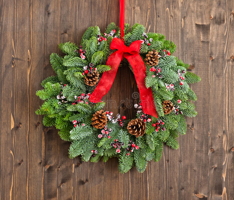 Advent wreath with red ribbon. Over wooden wall stock photo