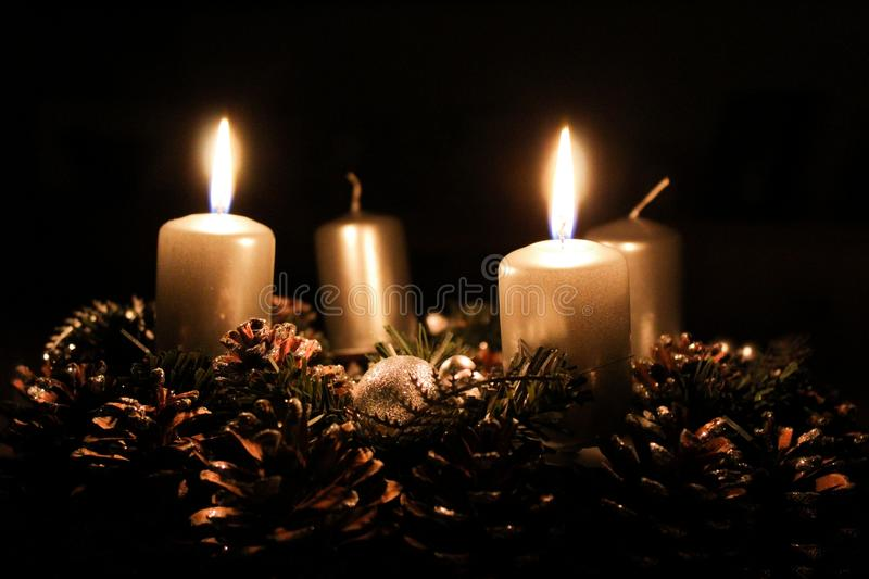Advent wreath with two candles lit stock photography