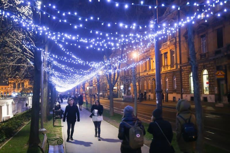 Advent in Zagreb, Croatia 2016. ZAGREB, CROATIA - DECEMBER 1th, 2016: Advent time in city center of Zagreb, Croatia. People walking down the illuminated plane stock image