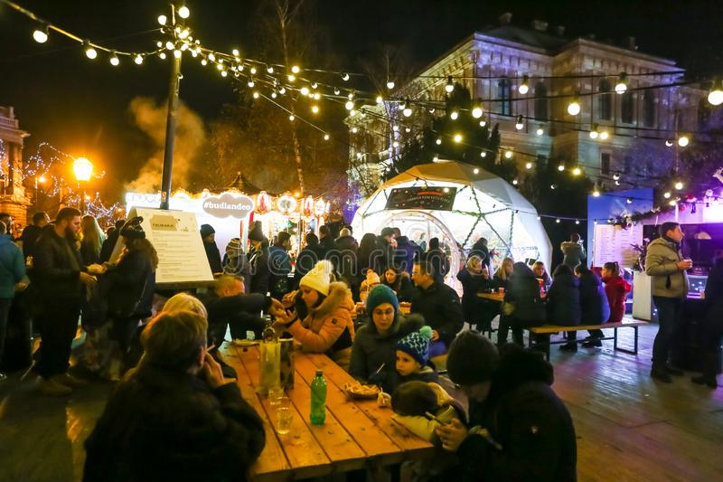 Advent Zagreb 2018. Zagreb, Croatia - December 13, 2018: Advent time in city center of Zagreb, Croatia. Large group of eople on the ornate food and beverage stock photography