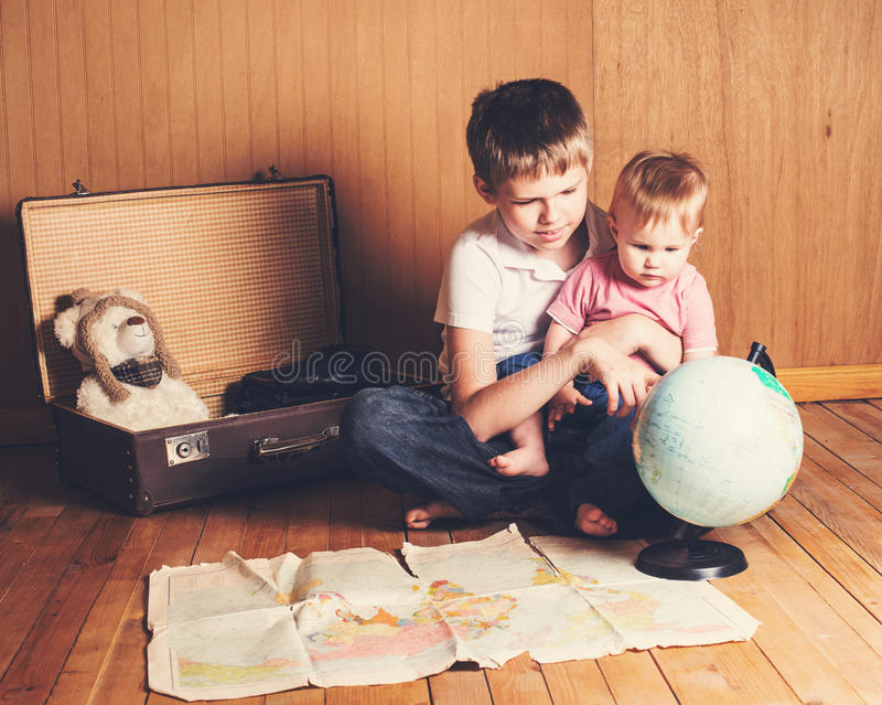 Adventure. Boy with his baby sister preparing for the journey. B royalty free stock photo