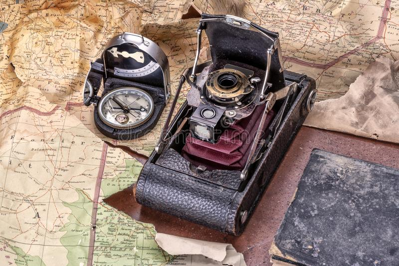 Adventure with camera, compass, map and diary for travel, exploration and discovery. Compass, map, photo camera and diary for travel, discovery, adventure and royalty free stock image