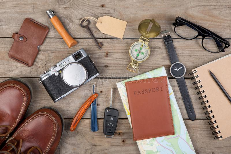 Adventure concept - camera, passport, map, notepad, compass and other stuff for travel royalty free stock images
