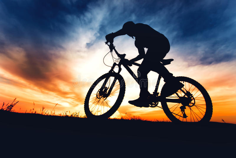 Adventure day with athlete on mountain bike on summer trail road stock photo