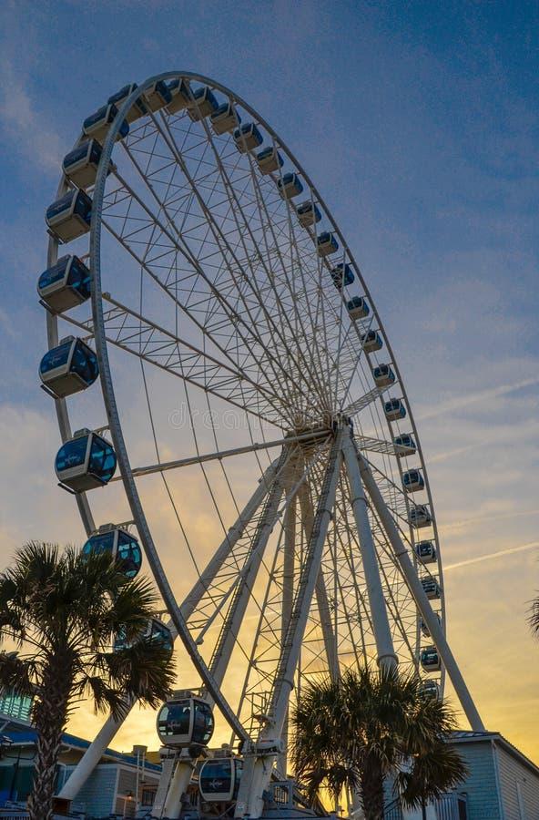 Ferris wheel at sunset. stock image